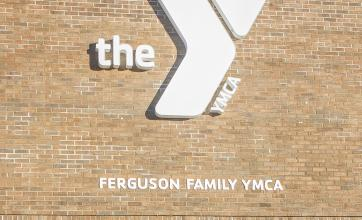 brick facade and white sign on exterior of the Ferguson Family YMCA