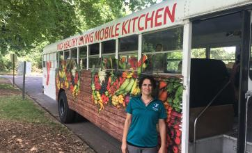 woman standing in front of nutrition bus