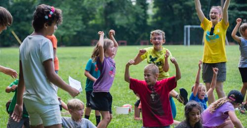 group of young campers playing outdoors